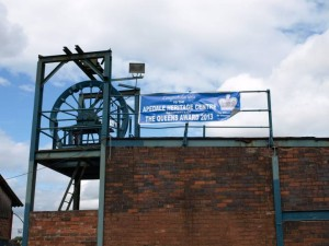 The old mine winding gear, with our banner announcing our Queens Award for Voluntary Service